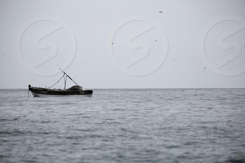 Boat adrift at sea photo