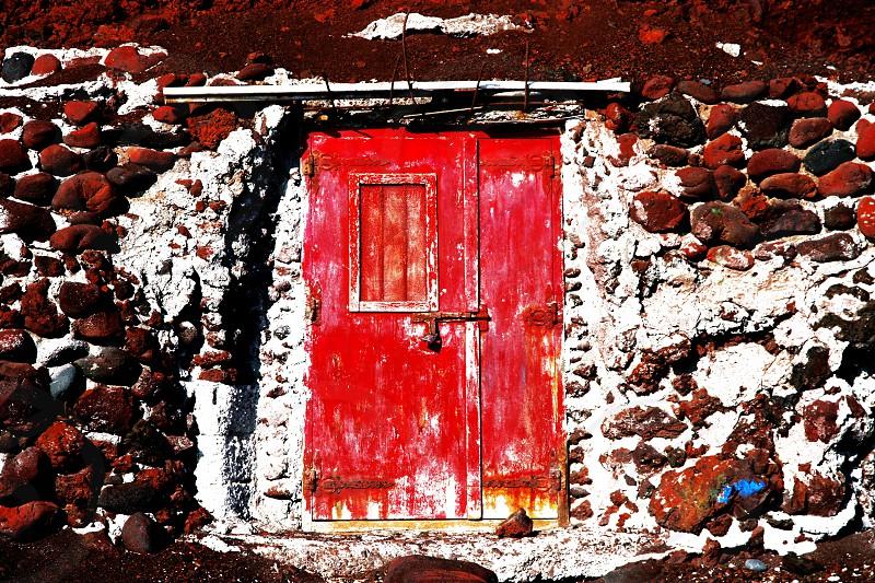 old red wood door peeling paint greece santorini stone earthy photo