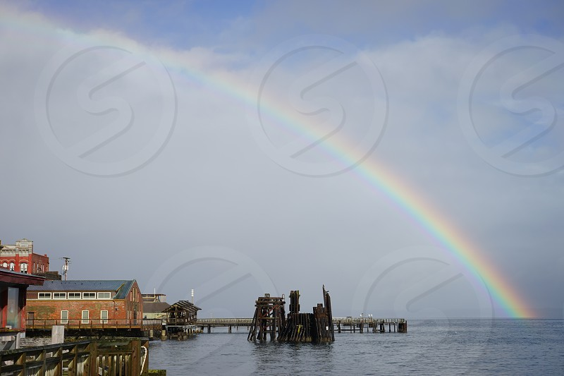 rainbow dock ferry piers waterfront buildings clouds transportation scenery fishing Port Townsend Washington State photo