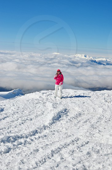 Woman being happy to discover the Top of the Mountain photo