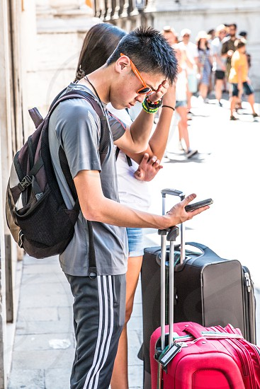 Teenagers Traveling And Using Mobile Phones photo
