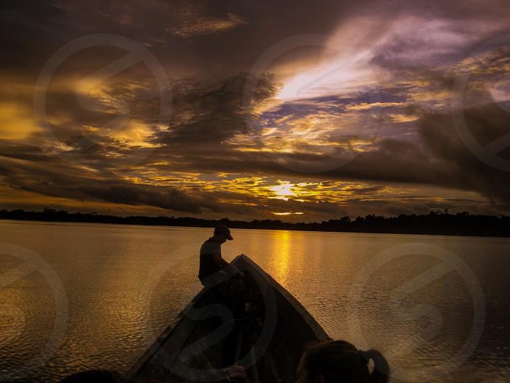 Sunset amazon lagoon river canoe boat photo