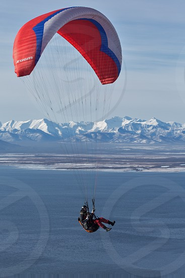 KAMCHATKA PENINSULA RUSSIA - NOVEMBER 21 2014: Paraglider flying on the background of the mountain and Avachinskaya Bay (Avacha Bay). photo