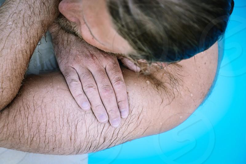 skin deep skin wet water top perspective  top view swimming pool  bare hair  photo