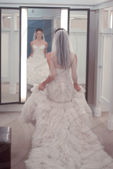 white wedding gown with sweetheart neckline and drop hem and full skirt photo