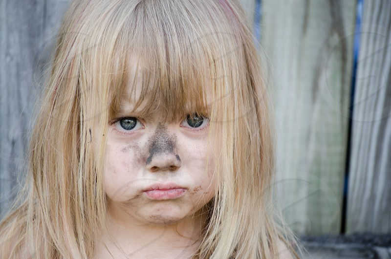 Little girl with dirty face photo