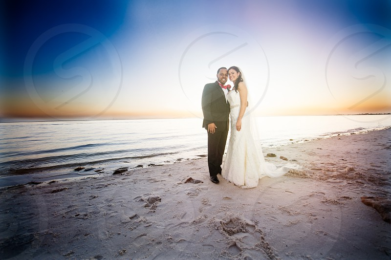 bride and groom by the beach photo