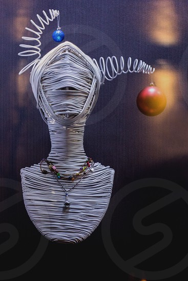 bust art with hanging baubles and jewelries photo