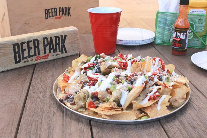 solo cup near nachos on plates photo