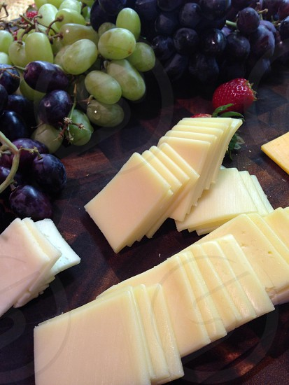 green grapes and sliced cheese photo