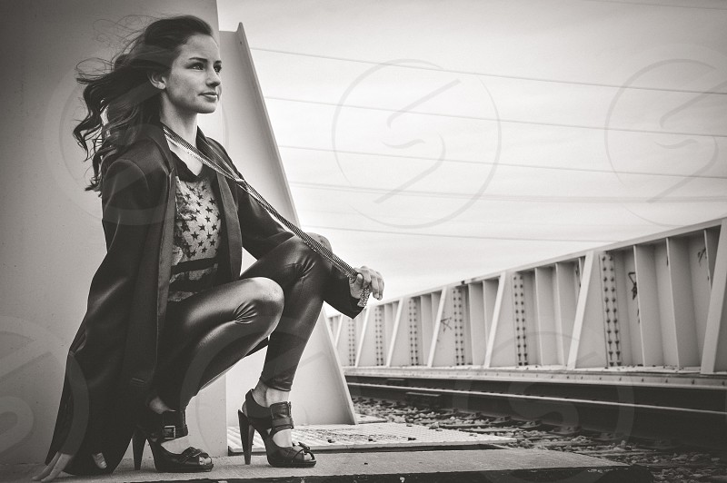 Cool chick in black on rail tracks photo