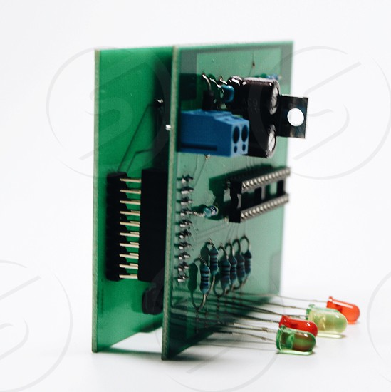 green board with electric connectors and transistors photo