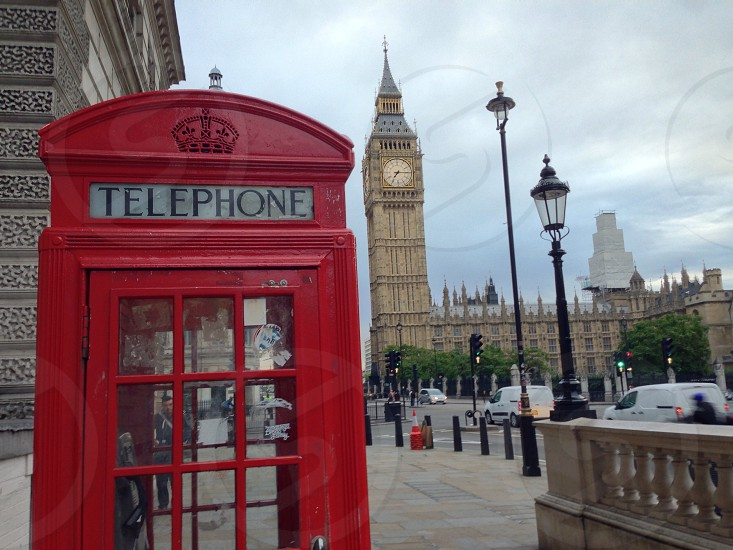 Red telephone booth and big ben tower photo