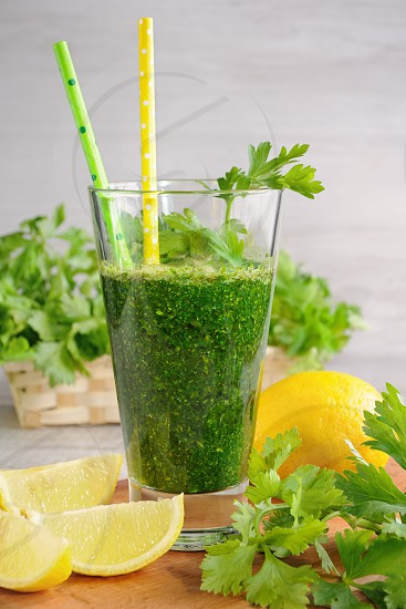 Fresh organic detox green smoothie with   parsley celery and lemon   photo