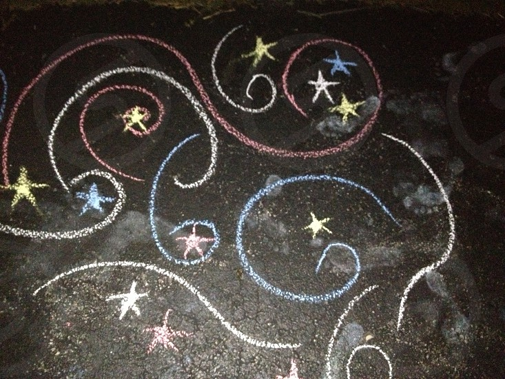 Chalk fireworks in a midnight sky. photo