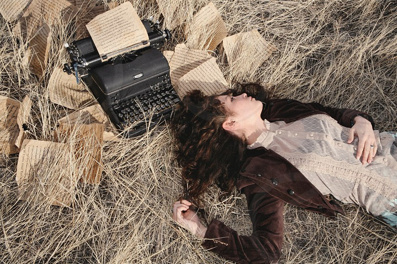 Vintage typewriter woman young curly hair beauty pensive letters love field romantic photo