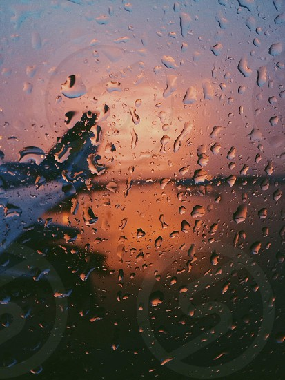 glass with raindrop photography photo