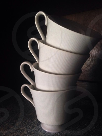 four white coffee mugs photo