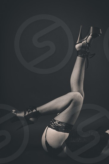 A woman's lower half posing in a provocative manor with lingerie  photo