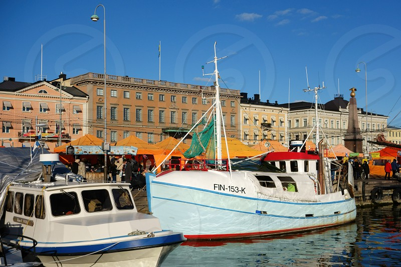 Helsinki Market Square in afternoon light the during annual Baltic Herring Fair in the beginning of October 2015.  photo