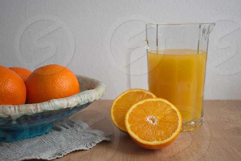 Oranges and orange juice on the table photo