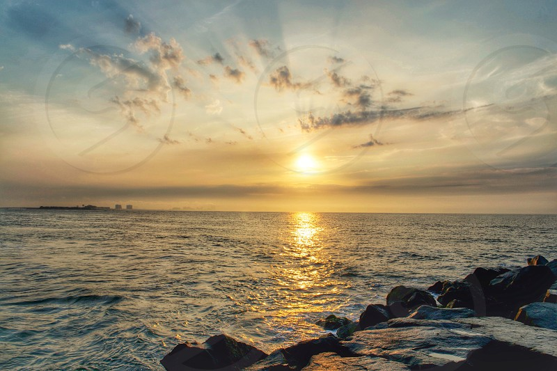 ocean and rocky coast at sunset photo