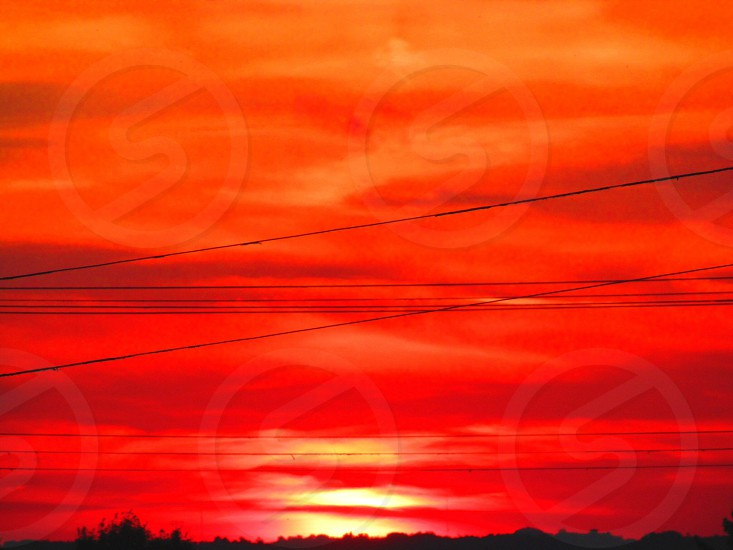 Blood red fiery sunset in Farrell Pennsylvania at summer' send photo