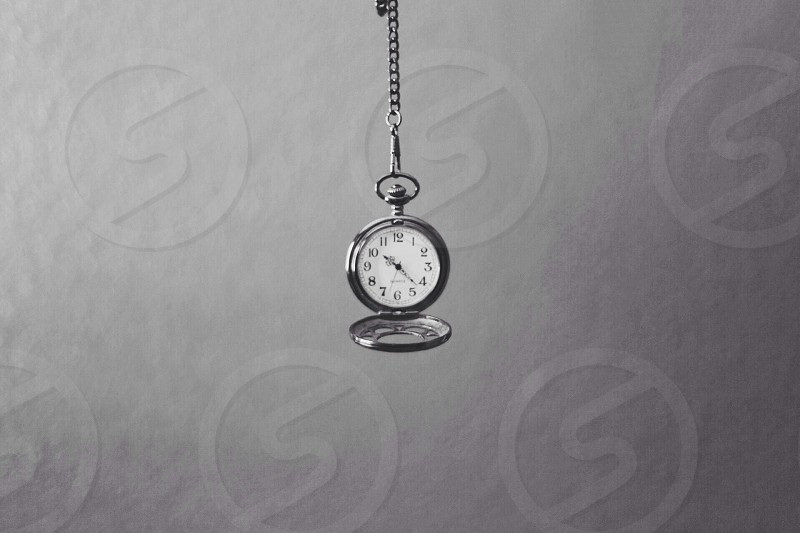 silver and white pocket watch photo