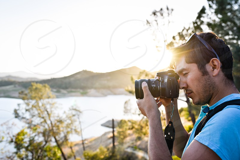 photographer sun flare glare sunshine canon camera dslr photo nature sunset picture man photo