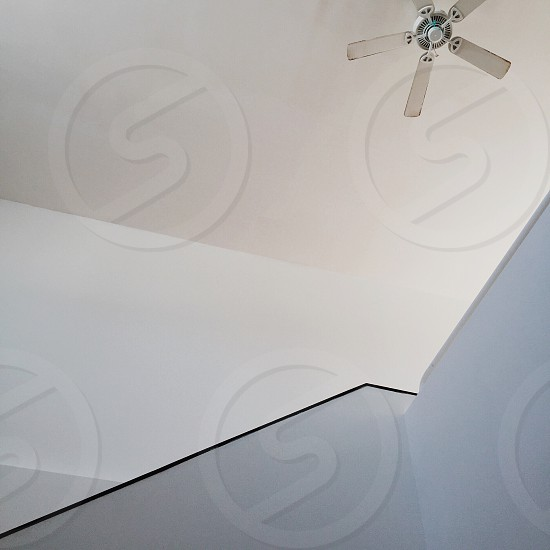 white five blade ceiling fan turned off photo