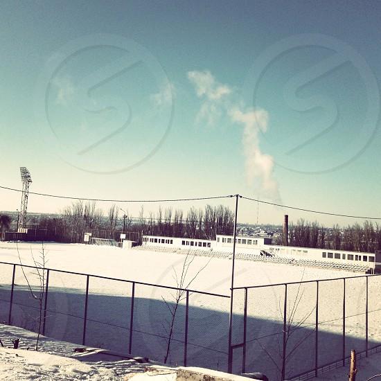 winter snow field sky smoke photo