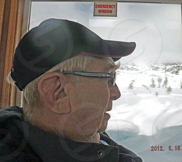Elderly man on a train trip in Alaska photo