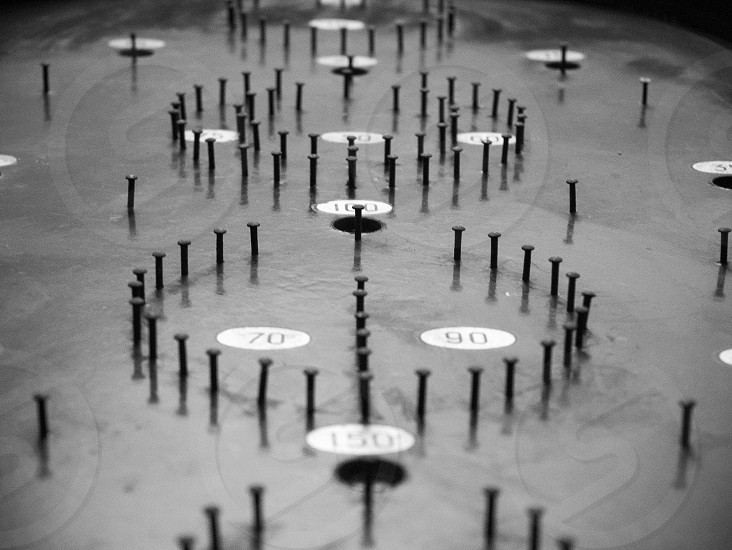 Detail of bagatelle board in black and white photo