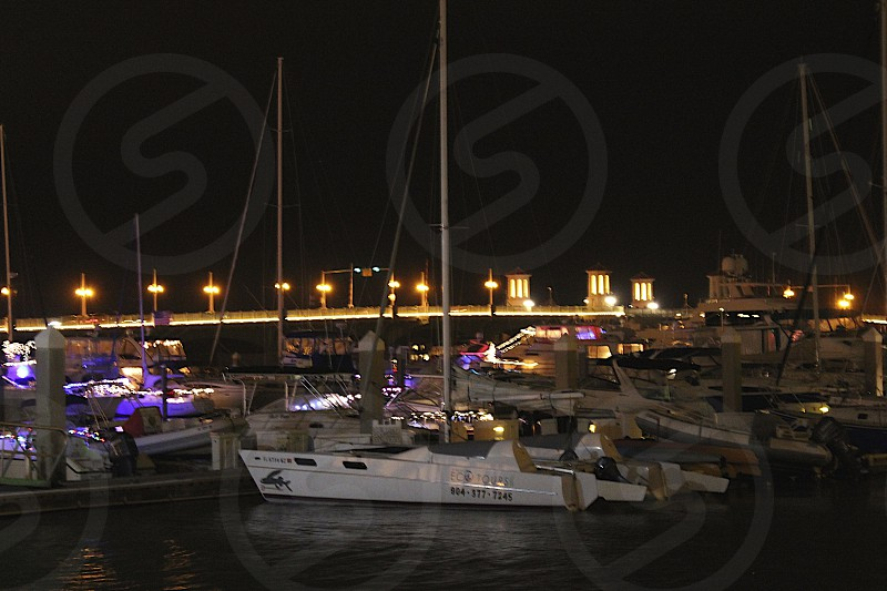 Boats lit up at night photo