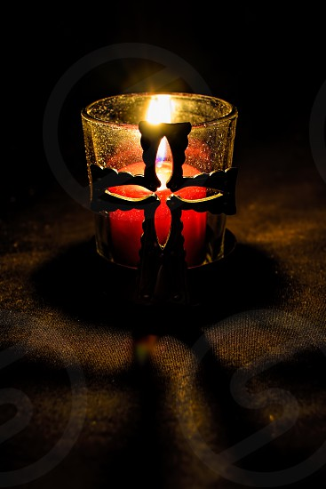 low-light photography of lighted red votive candle photo