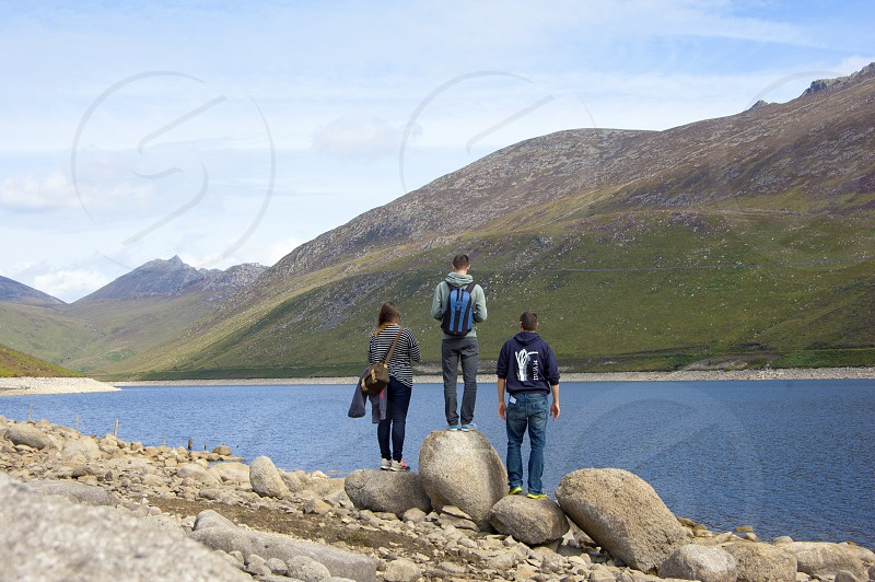 Mourne Mountains Northern Ireland Summer Walking Path stones standing spectators photo