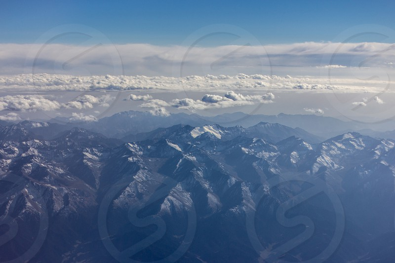 View on mountain ranges from a plane photo