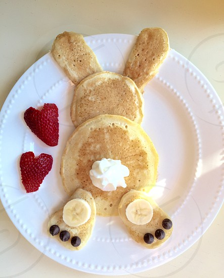 pancake bunny creation with bananas strawberries and chocolate chips photo