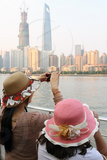 2 women standing taking photo photo