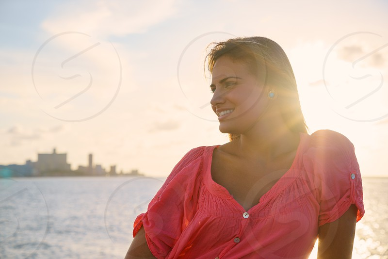 portrait; ocean; teen; tourism; tourist; vacations; people; 20s; adult; beach; beautiful; beauty; carefree; casual; caucasian; charming; cheerful; confident; copy space; cuba; enjoy; expression; female; flare; front view; girl; habana; happiness; happy; havana; head and shoulders; hispanic; holidays; latina; leisure; long hair; looking away; one; outdoor; person; relax; sea; sitting; smile; smiling; sunset; water; woman; young photo