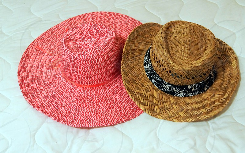 pink and brown woven straw hats photo