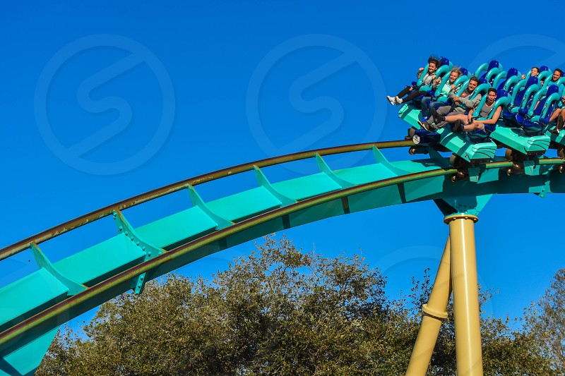 Orlando Florida . February 26  2019.  People enjoying terrific Kraken rollercoaster at Seaworld Theme Park (10) photo