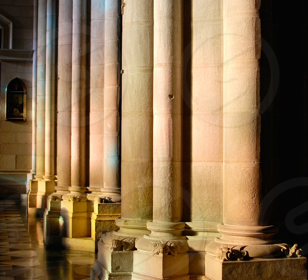 Light through stained glass on cathedral columns photo