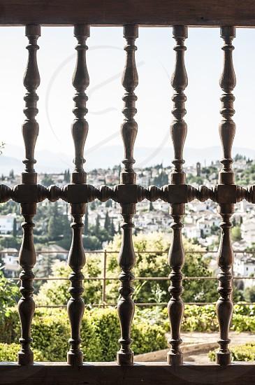 Wooden ornamental lattice window. Village view photo