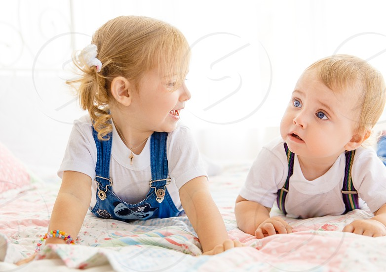 sibling rivalry kids boy girl photo