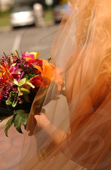Orange veil with bouquet photo
