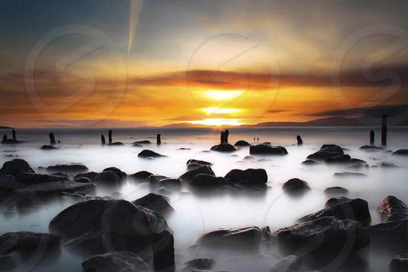 Sea ocean rocks sunset  photo