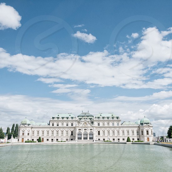 Belvedere palace vienna austria europe summer city travel baroque architecture building white grand blue sky photo