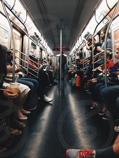 people riding train photo