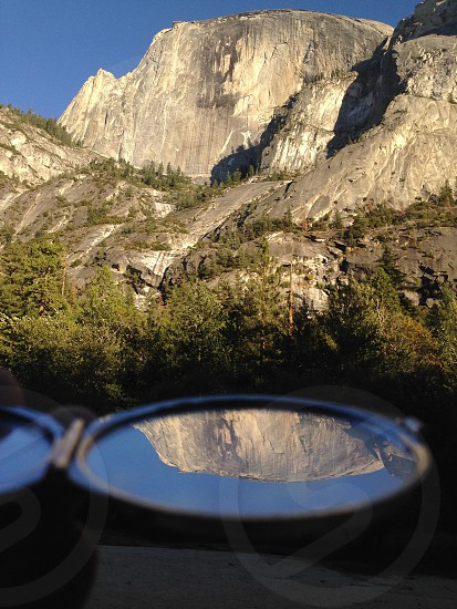 Half dome in Yosemite is reflected by a pocket mirror instead of a now-dry Mirror Lake that used to be there.  photo